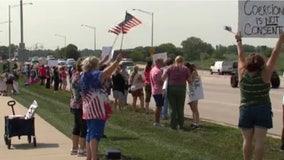 Dozens attend rally against Advocate Aurora's hospital employee vaccine mandate