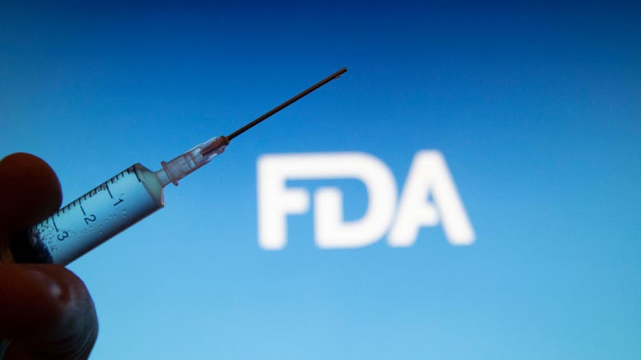 916644d9-In this photo illustration a medical syringe is seen with