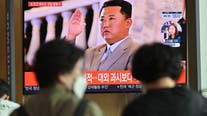North Korea holds toned-down military parade to celebrate founding