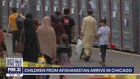 Flight carrying Afghan children arrives in Chicago