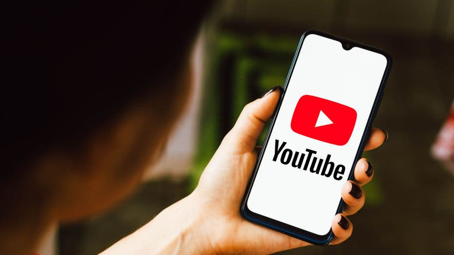 In this photo illustration the YouTube logo seen displayed