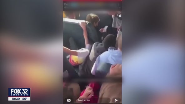 Video surfaces of Minooka student being put in head-lock, pinned to seat on school bus