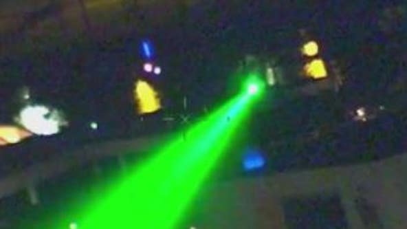 Men using a gun equipped with a green laser have robbed four people in Chicago