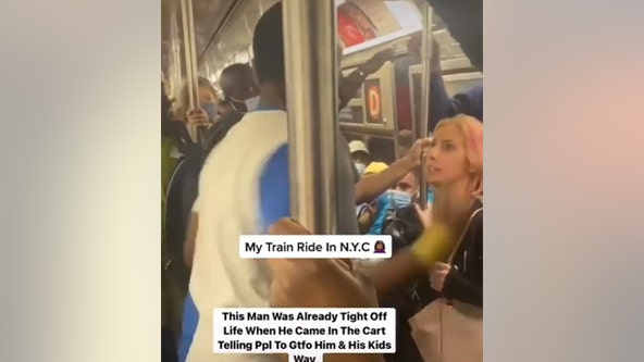 Video: Man punches woman in face on crowded subway
