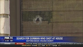 Search for gunman who shot at house