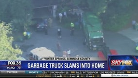 Garbage truck slams into Winter Springs home