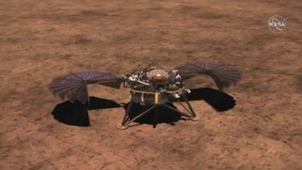 Mars lander's digger is burrowing again after snag