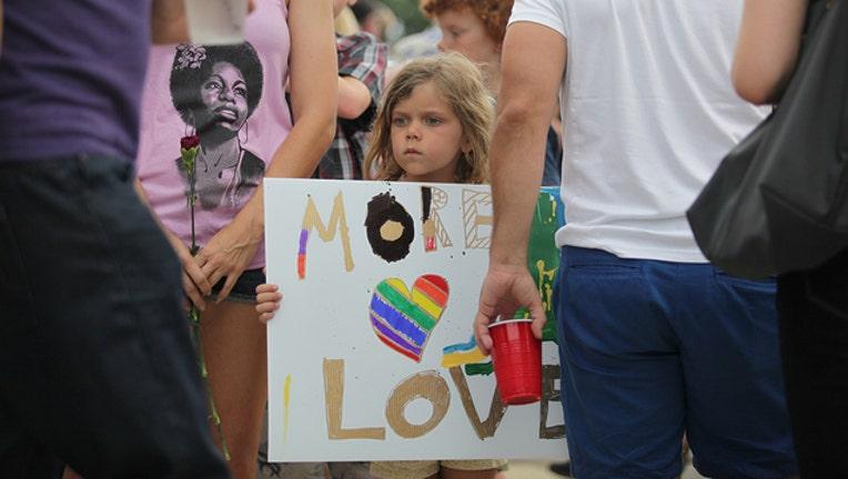 7bbc6df1-061316_vigil_for_victims_Dr. Phillips Center_Orlando_FL_9_1528773281618.jpg.jpg