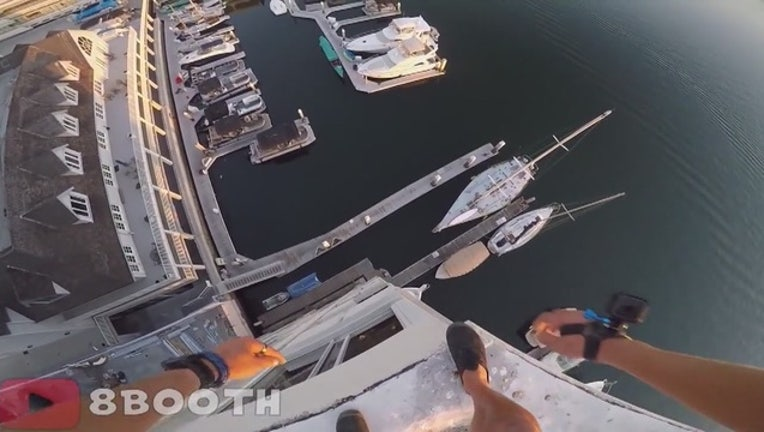 3e835d4b-Daredevil with GoPro jumps from Newport Beach dockside building-407068.JPG