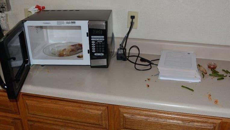 93360018-Boynton Beach Police Department_kitchen break in_011019_1547135469239.jpg.jpg