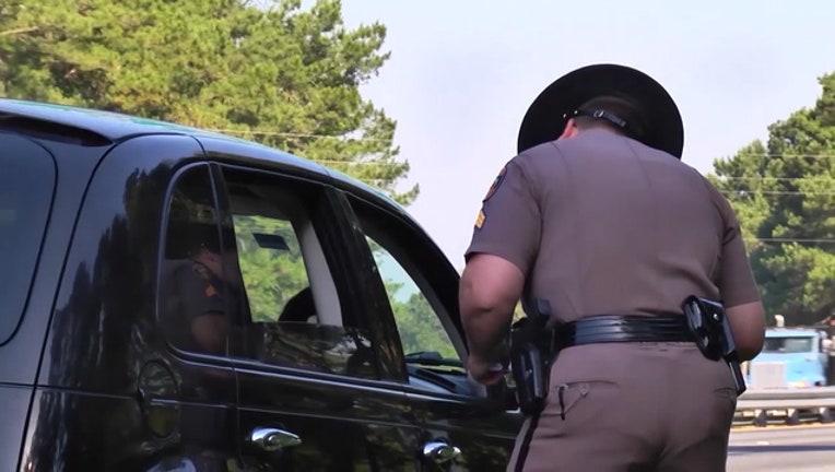 9acd38f0-Florida-highway-patrol-trooper-ticket-citation_1549059664235.jpg
