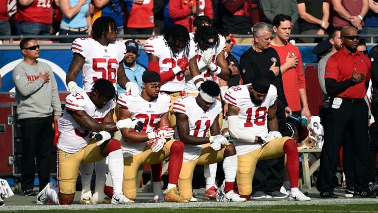 47ff4e9e-GETTY-NFL-kneeling_1527093508337-404023.jpg