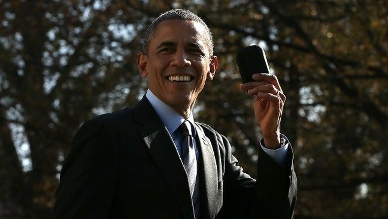 62e47715-GETTY Barack Obama Phone-401096