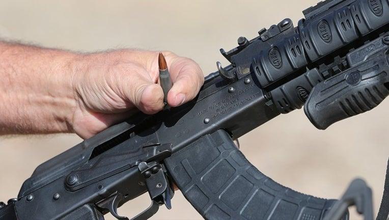 5c7219f9-GETTY_assault rifle_112618_1543258553272.png.jpg