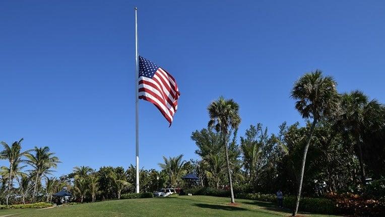 f16ba66f-GETTY_flag half staff mar a lago_080419_1564953998995.png.jpg