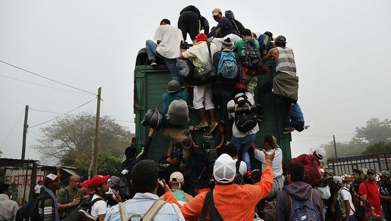 fa6c6eda-GETTY_migrant caravan_111218_1542043913043.png.jpg