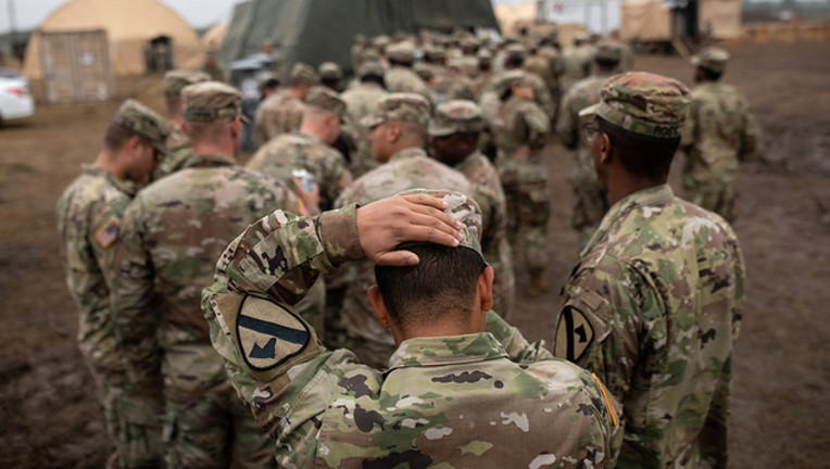 8be03cdd-GETTY_troops_120218_1543768184191.png