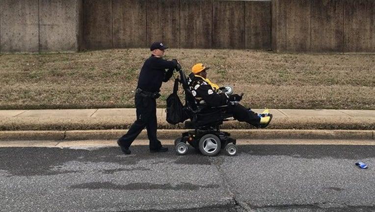 9eea5e98-MEMPHIS PD_wheelchair and officer_010619_1546791839874.png.jpg