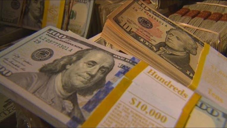 1c64a44f-money cash dollars rolls scams hundreds generic-409162