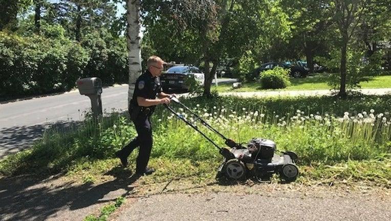 aaaab06a-ORONO POLICE DEPARTMENT_officer mows lawn_061019_1560164509941.png.jpg