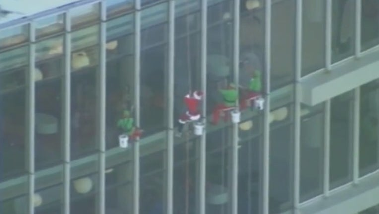 387bc8ae-SKYFOX_santa and elvis window washing nemours childrens hospital_121718_1545059173731.png.jpg