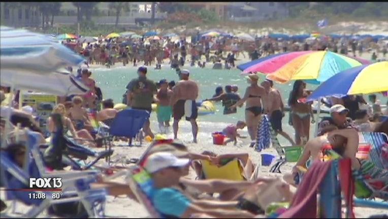 a479dbde-Tourism_busy beach-401385