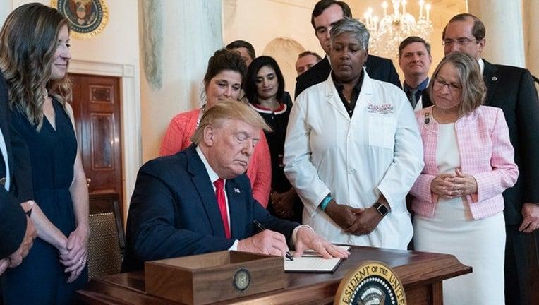 199367a6-WHITE HOUSE_trump signs health bill_062519_1561474796279.png.jpg