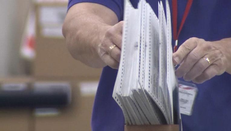 25d15804-ballots-voter-recount_1541811436123.jpg