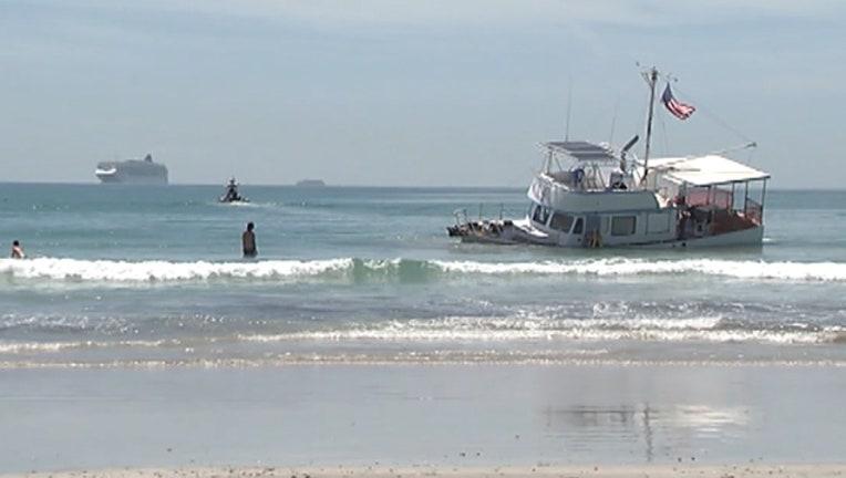 7e01ea5b-boat-grounded-jetty-park_1530572139631.jpg