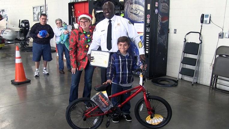 2a01a31a-boy-gets-bike-Orlando-firefighters_1545267220220.jpg