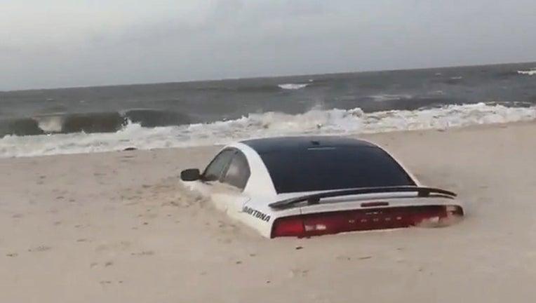 4376d1b9-car buried in sand_1563187772337.jpg-401385.jpg