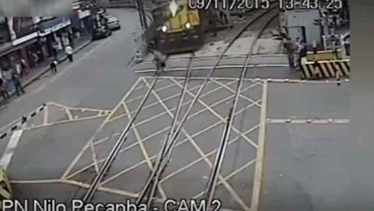 48a0b16e-Man narrowly misses being hit by train-402970