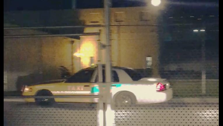 1553d64e-flager dui taxi officer car_1496000402660.png
