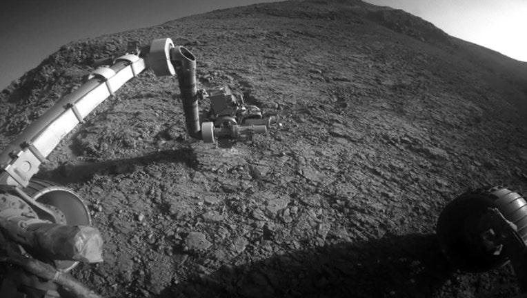 201b3e67-mars-opportunity-rover_1550018265002.jpg