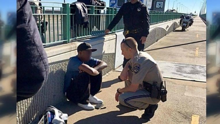 dc86d94e-officer talks man from jumping_1479465781209-404959.jpg