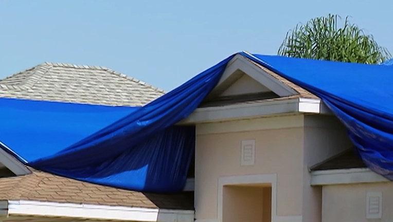 abe23f8d-roof-damage-tarps-hurricane-irma-repair_1506464364401.jpg