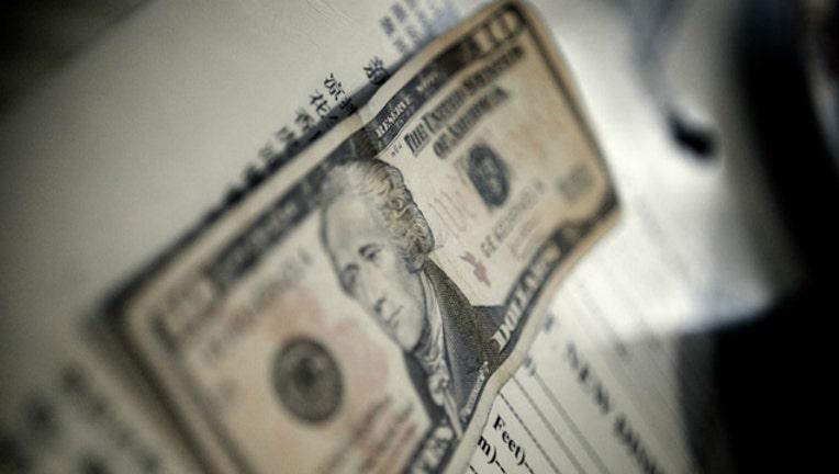 e3056da7-tip-money-tipping-cash_1499694455092-404023.jpg