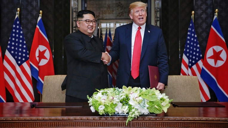 Donald Trump and Kim Jong-un (GETTY IMAGES)-401720