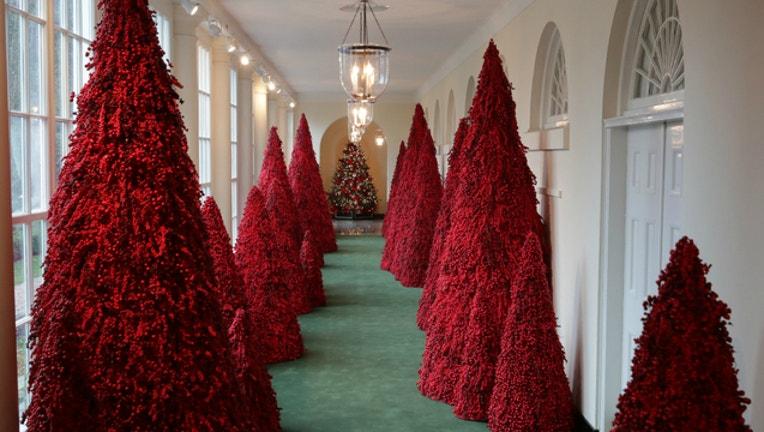 148a42d4-white house christmas red trees_1545518944425.jpg-401720.jpg