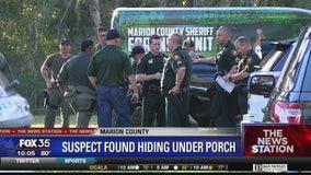 Suspect found hiding under porch