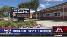 Suspects arrested after teen is carjacked at high school