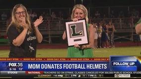 Mom donates football helmets to son's school