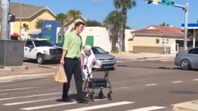 Publix employee helps elderly woman cross busy Florida street
