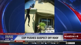 Investigation after officer pushes suspect off roof