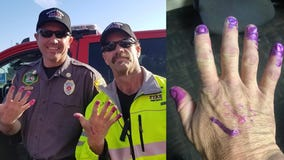 Firefighters comfort scared girl after car crash by allowing her to paint their nails