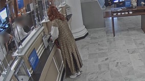 Accused bank robber dressed as woman held without bond