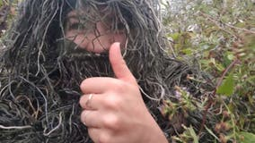 Woman disguises herself as bush to photograph sister's engagement