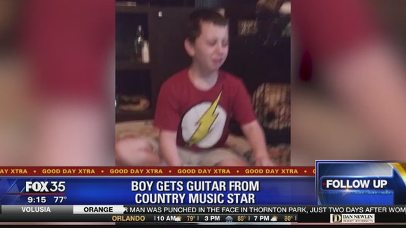 Boy gets guitar from country music star