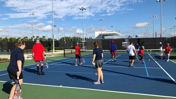 Wounded warriors from around the country in Central Florida to learn adaptive tennis