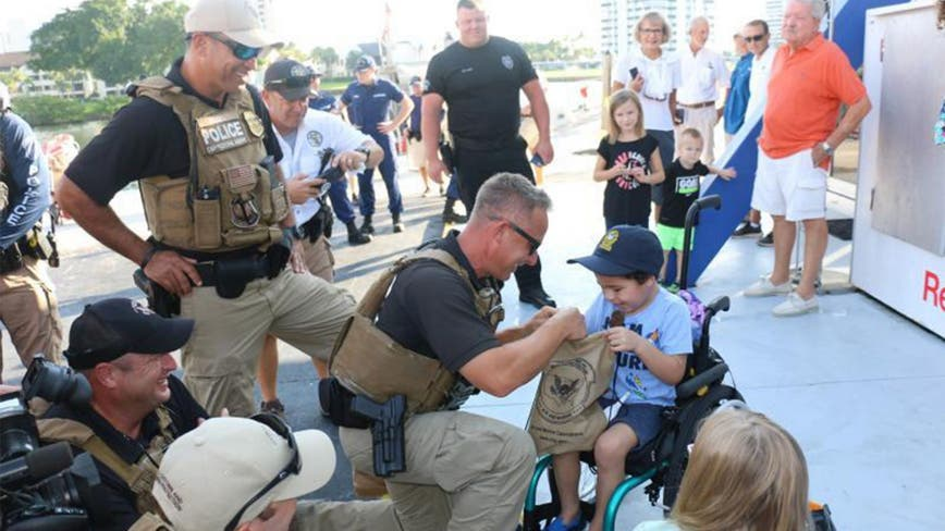 Florida boy, 5, battling aggressive brain cancer gets to patrol with Coast Guard, police